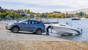 Car towing boat